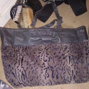 A tiger print fur front gray purse